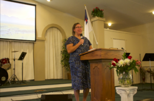 Candy presenting her ministry at a church